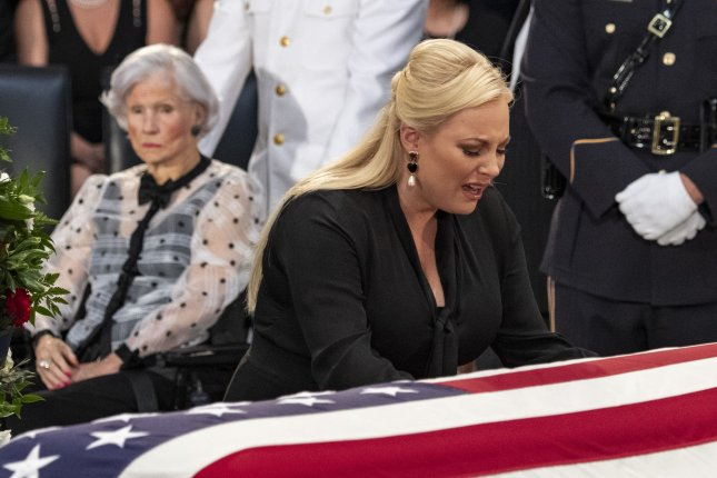 Meghan McCain and John McCain's mother Roberta McCain (L) pay their respects as the former senator lies in state at the U.S. Capitol in Washington, D.C. on August 31. Meghan is returning as a co-host of The View next week. File Photo by Pat Benic/UPI