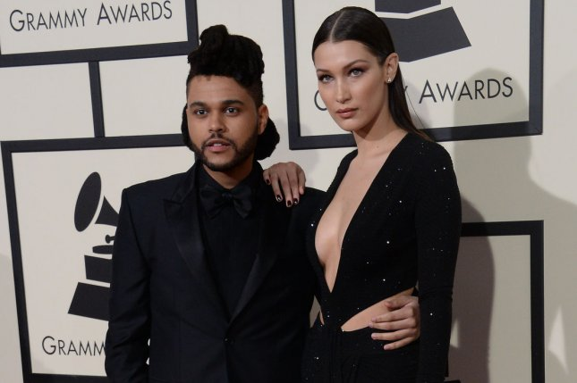 Bella Hadid (R), pictured with The Weeknd, couldn't help but gush about the singer in a 73 Questions interview with Vogue. File Photo by Jim Ruymen/UPI