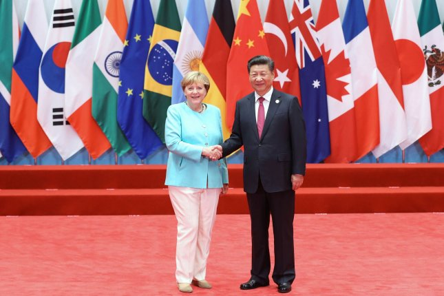 Chinese President Xi Jinping and German Chancellor Angela Merkel are to discuss the final details of a EU-China investment agreement on Wednesday, according to reports. Pool Photo by Ma Zhancheng /UPI