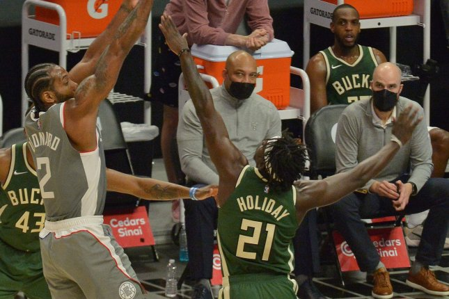 Milwaukee Bucks guard Jrue Holiday (21) could make up to $160 million under the four-year extension. File Photo by Jim Ruymen/UPI