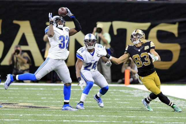 Detroit Lions strong safety Tavon Wilson (32) intercepts a Drew Brees pass intended for New Orleans Saints receiver Willie Snead (83) as Detroit Lions cornerback Nevin Lawson (24) looks on in the fourth quarter at the Mercedes-Benz Superdome in New Orleans December 4, 2016. Photo by AJ Sisco/UPI