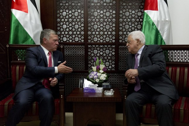 Palestinian President Mahmoud Abbas (R) meets with Jordan's King Abdullah II at his office in the West Bank city of Ramallah on Monday. Pool photo by Nasser Nasser/UPI