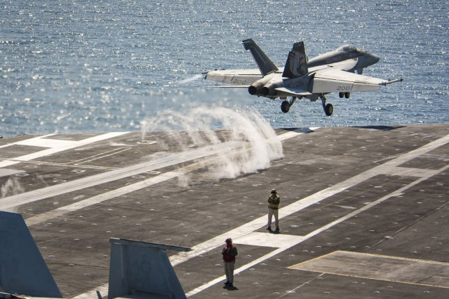 An F/A-18E Super Hornet from the Kestrels of Strike Fighter Squadron 137 launches in 2017 from an aircraft carrier in the Pacific. Raytheon was awarded a contract modification for configuration work on the Super Hornet, as well as the Growler variant. File Photo by MC3 Matthew Granito/U.S. Navy/UPI