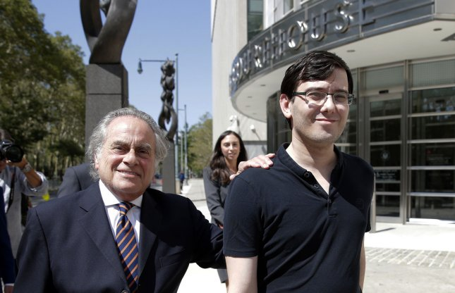 Attorney Benjamin Brafman puts his hand on the shoulder of former Turing Pharmaceuticals CEO Martin Shkreli as he exits the United States Federal courthouse after being found guilty of multiple criminal charges in his federal securities fraud trial on Aug. 4, 2017 in New York City. Photo by John Angelillo/UPI