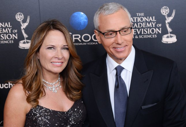 Dr. Drew and wife Susan Pinsky arrive for the The National Academy of Television Arts & Science's 40th annual Daytime Emmy Awards at the The Beverly Hilton in Beverly Hills, California on June 16, 2013. UPI/Jim Ruymen