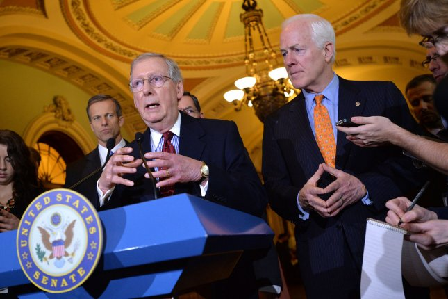 Senate Minority Leader Mitch McConnell (R-KY), joined by Sen John Cornyn (R-TX), speaks on the Senate budget deal on Capitol Hill in Washington, D.C. on December 17, 2013. UPI/Kevin Dietsch