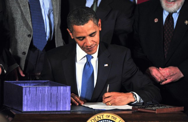 President Barack Obama signs the National Defense Authorization Act for 2010 in the East Room of the White House in Washington on October 28, 2009. The bill included the Matthew Shepard Hate Crimes Prevention Act which expands upon 1969 U.S. federal hate-crime law by extending its scope to protect crimes motivated by a victim's gender, sexual orientation or gender identity. UPI/Kevin Dietsch