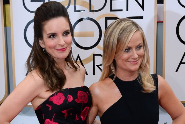 Golden Globes co-hosts Tina Fey (L) and Amy Poehler arrive for the 71st annual Golden Globe Awards at the Beverly Hilton Hotel in Beverly Hills, California on January 12, 2014. UPI/Jim Ruymen