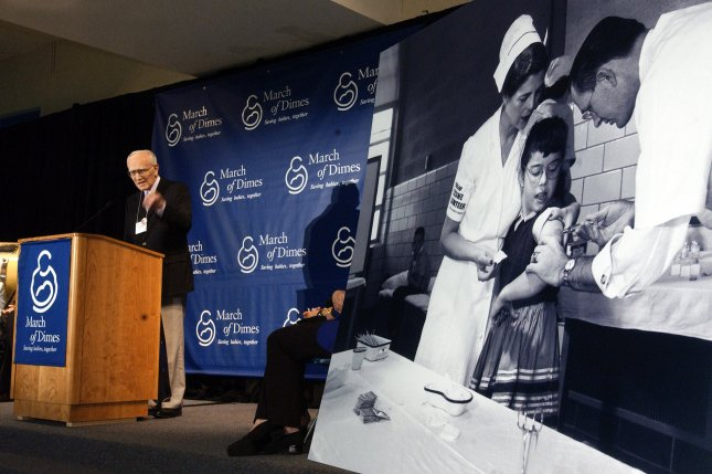 Dr. Richard Mulvaney speaks on the 50th anniversary of the first Polio vaccine, on April 26, 2004, at Franklin Sherman Elementary School in McLean, Va., the place where the first shots were given. The photo at right is of Mulvaney giving one of the first shots to Jacqueline Lonergan. The first Salk vaccine inoculations were given on April 26, 2004, and eventually led to the erradication of Polio in most of the world. (UPI Photo/Roger L. Wollenberg)