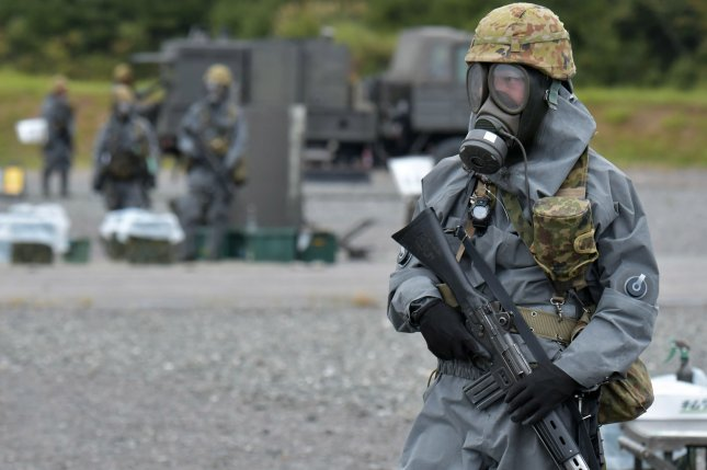A member of Japan's Ground Self-Defense Force takes part in a joint military exercise. Japan's defense chief is under fire for previously suggesting a nuclear strategy for the country, and for saying a military conscription policy would not violate Japan's constitution. File Photo by Keizo Mori/UPI