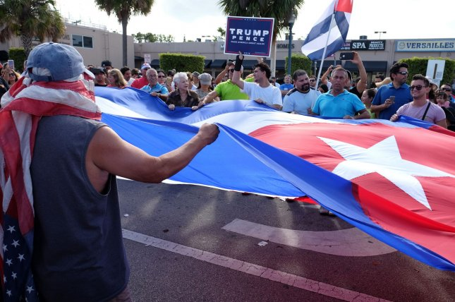Cuban-Americans celebrate the death of former Cuban leader Fidel Castro in the streets of Little Havana in Miami, Florida, November 26, 2016. Castro died in Cuba on November 25, 2016 at the age of 90. Photo by Gary I Rothstein/UPI