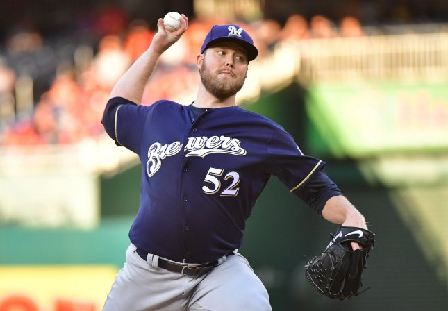 Milwaukee Brewers pitcher Jimmy Nelson throws from the mound in a game against the Washington Nationals in July. Photo by Kevin Dietsch/UPI
