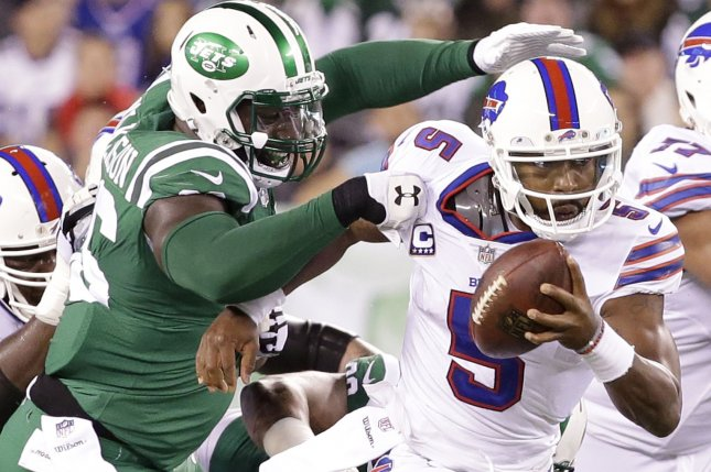 d87147a19 New York Jets  Muhammad Wilkerson grabs the jersey of Buffalo Bills  Tyrod  Taylor in the first half in Week 9 of the NFL season on November 2 at  MetLife ...