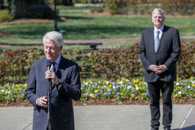 Former President Bill Clinton talks about the effect Billy Graham had on his life as Franklin Graham listens. Clinton visited to pay respects to Billy Graham, who died Wednesday as he lies in repose at the Billy Graham Library in Charlotte, N.C. Photo by Nell Redmond/UPI