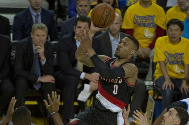 Portland Trail Blazers point guard Damian Lillard (0) puts up a shot against the Golden State Warriors in the third quarter of game two of the NBA Western Conference Semifinals on May 3, 2016 at Oracle Arena in Oakland, California. File photo by Terry Schmitt/UPI