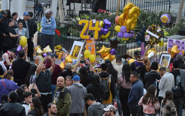 Thousands of fans have gathered around a number of makeshift memorials throughout the day to pay tribute to Kobe Bryant, his 13-year-old daughter Gianna and seven other passengers killed in a Calabasas helicopter crash early Sunday morning, in Xbox Plaza outside Staples Center in Los Angeles on Tuesday, January 28, 2020. Photo by Jim Ruymen/UPI