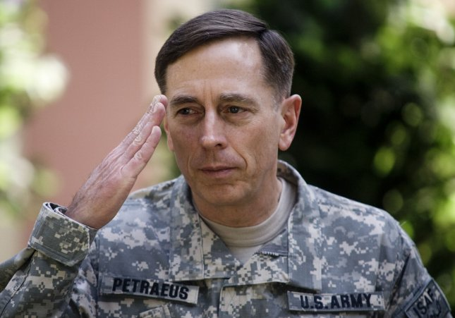 Commander of NATO forces in Afghanistan U.S. General David Petraeus salutes during in a change of command ceremony at ISAF Headquarters in Kabul on July 4, 2010. Petraeus received the flags of the United States and NATO forces to mark his formal assumption of command in Afhanistan. UPI/Hossein Fatemi.