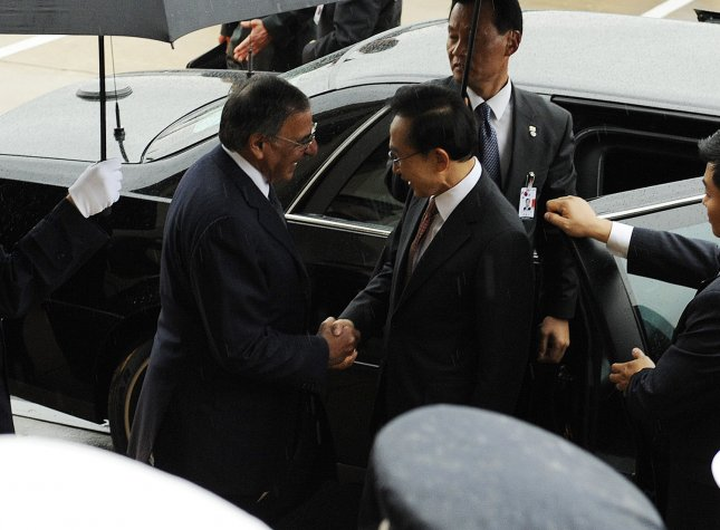 Defense Secretary Leon Panetta shakes hands with President of the Republic of Korea Lee Myung-bak on October 12, 2011. FILE/UPI/Roger L. Wollenberg