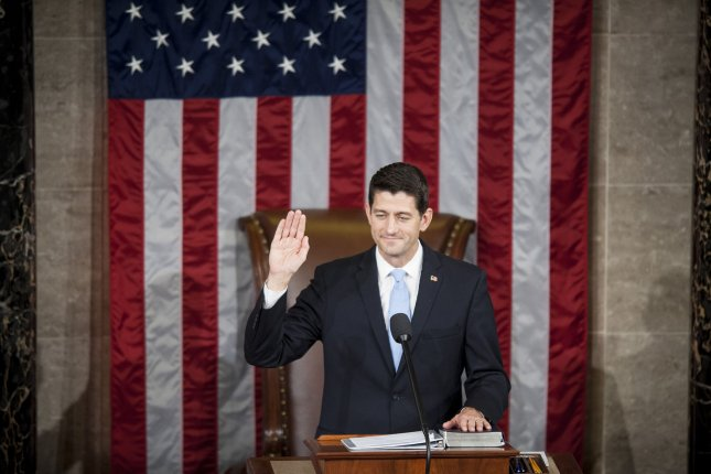 Speaker of the House Paul Ryan, R-Wis., is sworn in Thursday after being elected speaker of the House of Representatives in Washington, D.C. Earlier the outgoing Speaker, Rep. John Boehner, R-Ohio, gave his farewell address to Congress. He is retiring Friday. Photo by Pete Marovich/UPI