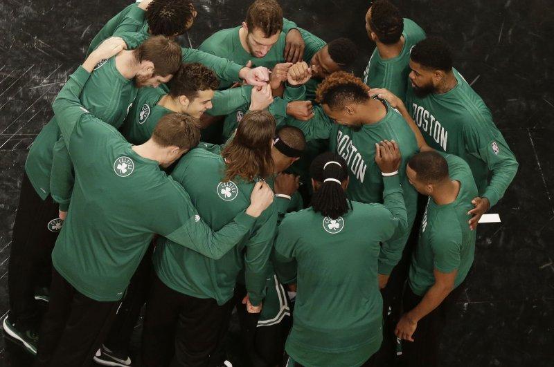 The Boston Celtics huddle up. Photo by John Angelillo/UPI