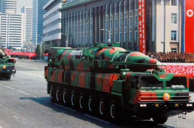 North Korea is increasingly touting its nuclear weapons capabilities, and concern is growing in the United States and Japan about its missiles development. This photo of a long-range missile launcher was displayed on a picture board in front of the North Korean embassy in Beijing in 2013. File Photo by Stephen Shaver/UPI