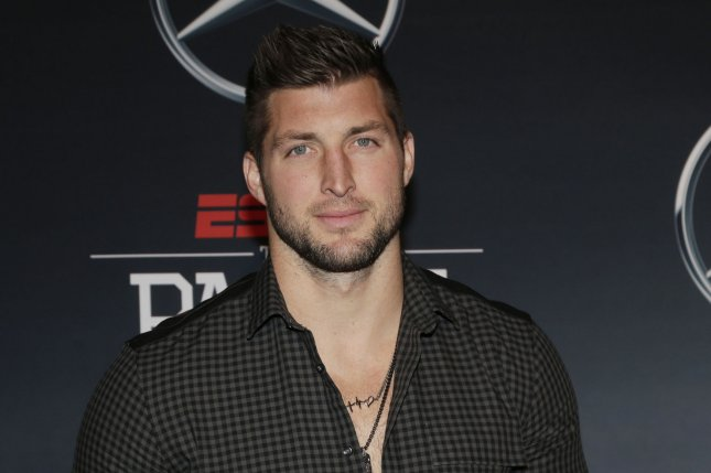 Tim Tebow arrives on the red carpet for ESPN The Party on February 5, 2016 in San Francisco, California. Photo by John Angelillo/UPI