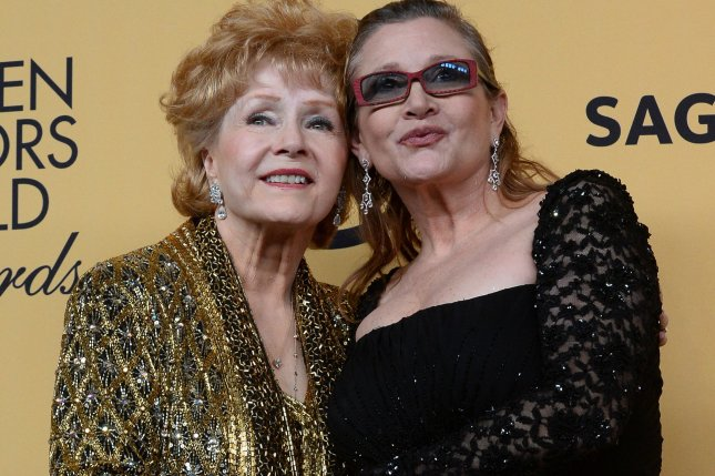 Debbie Reynolds, 84, died in Los Angeles on December 28, 2016, one day after her daughter Carrie Fisher (R) died. Fisher, 60, suffered a heart issue on a flight from London to Los Angeles Dec. 23. The women are shown here in January 2015 when Reynolds received the Screen Actors Guild Lifetime Award. File Photo by Jim Ruymen/UPI