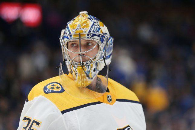 Nashville goaltender Pekka Rinne of Finland skates to his bench during a time out against the St. Louis Blues at the Scottrade Center in St. Louis, Mo. Photo by Bill Greenblatt/UPI