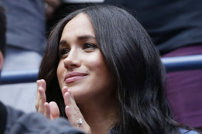 Meghan Markle, duchess of Sussex, claps her hands before Bianca Andreescu of Canada plays Serena Williams at the U.S. Open on September 7 at Arthur Ashe Stadium in New York City. Markle turns 39 on August 4. File Photo by John Angelillo/UPI
