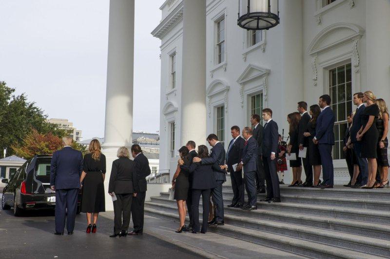President Donald Trump, first lady Melania Trump, family and friends wait as pallbearers load the casket of Robert Trump. Photo by Tasos Katopodis/UPI