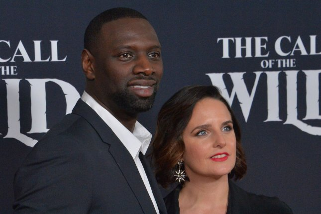 Omar Sy (L) and his wife, Helene Sy, attend the premiere of The Call of the Wild in February 2020. Sy discussed learning English and his show Lupin on Jimmy Kimmel Live. File Photo by Jim Ruymen/UPI