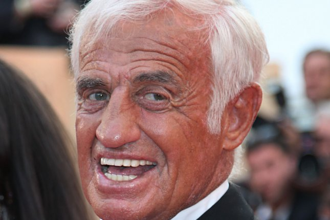 Jean-Paul Belmondo arrives on the red carpet before a tribute honoring his 50-year career during the 64th annual Cannes International Film Festival on May 17, 2011. File Photo by David Silpa/UPI