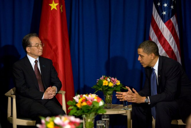 Chinese Premier Wen Jiabao (L) visits with U.S. President Barack Obama at the United Nations Climate Change Conference in Copenhagen, Denmark, Dec. 18, 2009. UPI/Pete Souza/White House