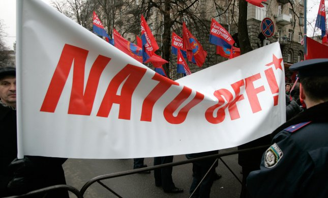 Protesters hold an anti-NATO banner outside of the presidential residence in Kiev during a visit by Russian President Putin in Kiev on December 22, 2006. (UPI Photo/Anatoli Zhdanov)