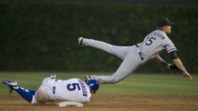 Chicago Cubs' Reed Johnson upends Chicago White Sox second baseman Gordon Beckham after Beckham threw to first base to complete a double play during the sixth inning at Wrigley Field on May 19, 2012, in Chicago. UPI/Brian Kersey