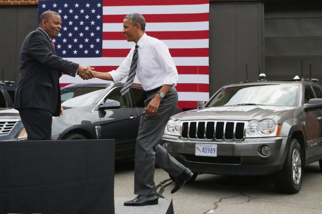 U.S. President Barack Obama (C) is welcomed to the stage by Transportation Secretary Anthony Foxx at the The Federal Highway Administration's Turner-Fairbank Highway Research Center in Mclean, Virginia on July 15, 2014. The center is home to 20 laboratories and conducts applied and exploratory advanced research in vehicle-highway interaction, nanotechnology, and a host of other types of transportation research fro better safety. UPI/Chip Somodevilla/Pool