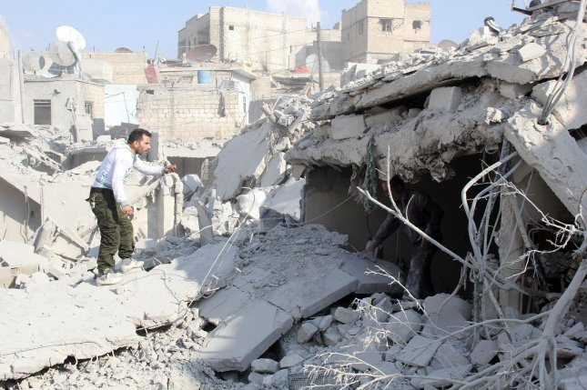 A Syrian man looks for survivors under the rubble of destroyed houses on October 30, 2015, following what local activists say was an airstrike by Russian aircraft in the rebel-held area of Kallasah, on the outskirts of Aleppo, Syria. Wednesday, peace talks aimed at ending the five-year civil war were suspended until Feb. 25. File Photos by Ameer Alhalbi/ UPI