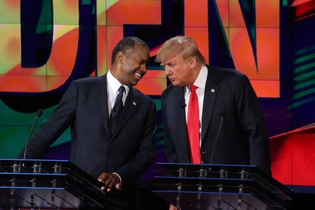 Ben Carson, left, and Donald Trump share a light moment at the conclusion of a Republican debate in Las Vegas last year. Carson dropped out of the race last week and will reportedly endorse Trump on Friday. File photo by Ruth Fremson/UPI