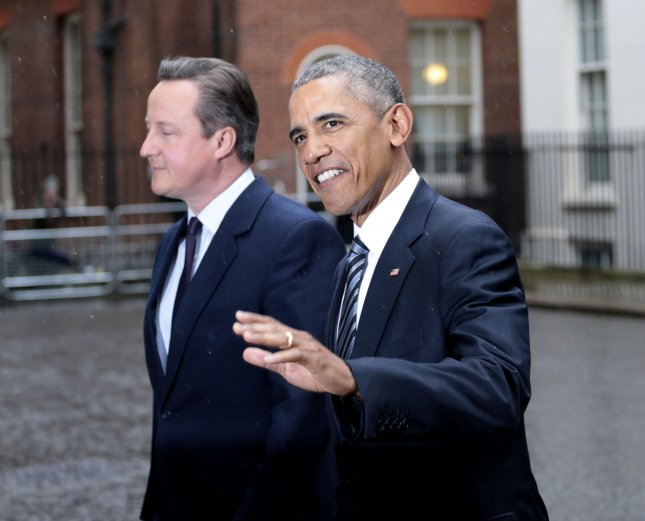 British Prime Minister David Cameron and President of the United States Barack Obama wave to the International media at No.10 Downing St, London on April 22, 2016. President Obama is on a three day trip to the UK where he will meet the Queen and other dignitaries during his stay. Photo by Hugo Philpott/UPI