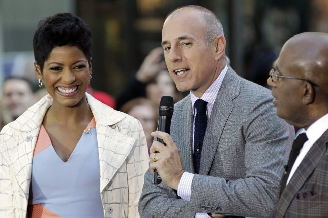 Tamron Hall (left to right) with Matt Lauer and Al Roker prior to Bastille's performance on Today on October 6, 2014. File Photo by John Angelillo/UPI