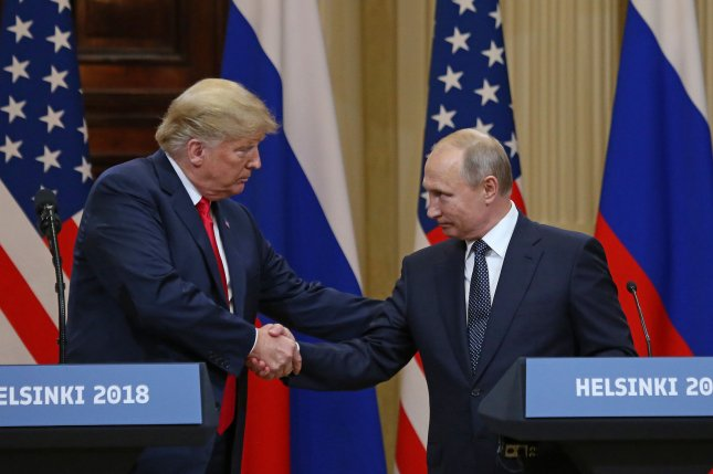 U.S. President Donald Trump shakes hands with Russian President Vladimir Putin at the Presidential Palace in Helsinki, Finland, during a summit on July 16, 2018. File Photo by David Silpa/UPI