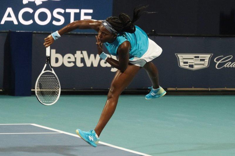Cori Coco Gauff hits a serve during her loss to Anastasija Sevastova at the Miami Open on Thursday in Miami Gardens, Fla. Photo by Gary I Rothstein/UPI
