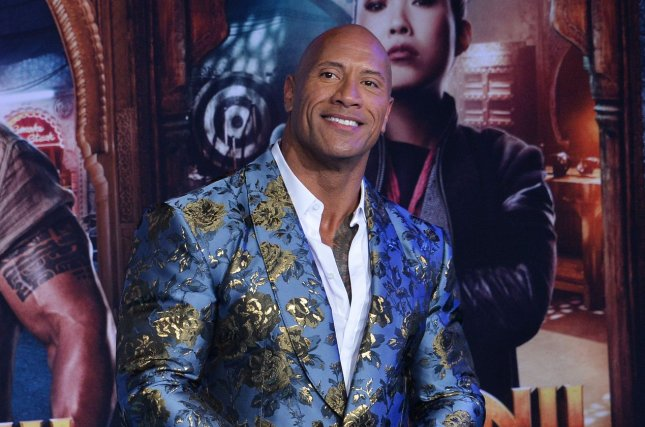 Dwayne Johnson stars in and produces the Netflix film Red Notice. File Photo by Jim Ruymen/UPI