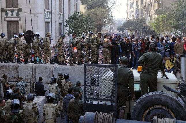 Military personnel erect a concrete barrier to separate police and protestors just off Cairo's Tahrir square on November 24, 2011. Members of Egypt's ruling military council rejected calls to step down immediately, saying it would amount to a betrayal as anti-military protests entered their seventh day. UPI/Mohamed Hossam
