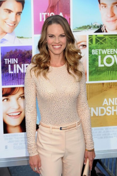 Hilary Swank reportedly has fired members of her staff after she drew criticism from human-rights activists for attending a party for Chechnya's autocratic president Ramzan Kadyrov. UPI/Jim Ruymen