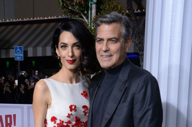 George Clooney (R) and wife Amal Clooney at the Los Angeles premiere of Hail, Caesar! on February 1. The couple married in 2014. File Photo by Jim Ruymen/UPI