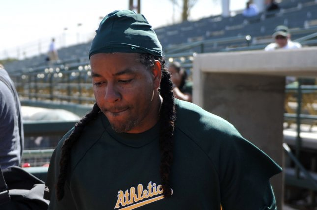 Manny Ramirez of the Oakland Athletics leaves the dugout during batting practice before the Athletics Cactus League spring training game against the Los Angeles Dodgers at Phoenix Municipal Stadium in Phoenix, Arizona on March 7, 2012. UPI/Art Foxall