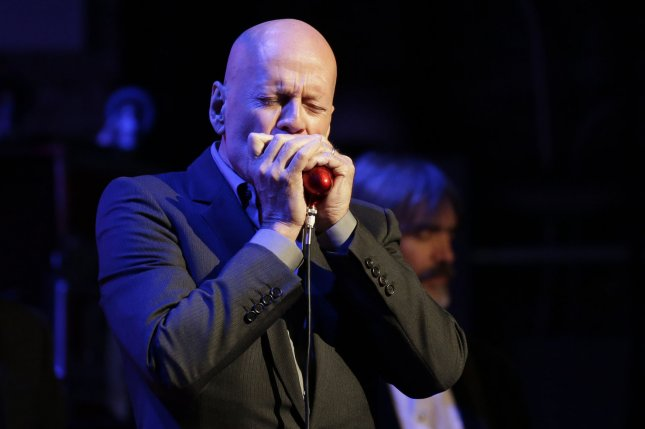 Bruce Willis plays harmonica when he performs at the God's Love We Deliver's Love Rocks NYC! benefit concert in New York City on March 9. The actor will be seen this fall in a remake of Death Wish. File Photo by John Angelillo/UPI
