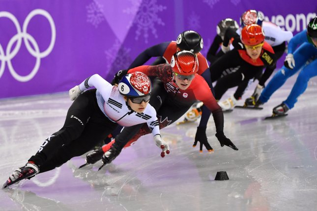Choi Min Jeong, left, leads Kim Boutin of Canada during the Ladies 1500m Short Track Speed Skating finals at the Pyeongchang 2018 Winter Olympics Saturday at the Gangneung Ice Arena in Gangneung, South Korea. Photo by Richard Ellis/UPI