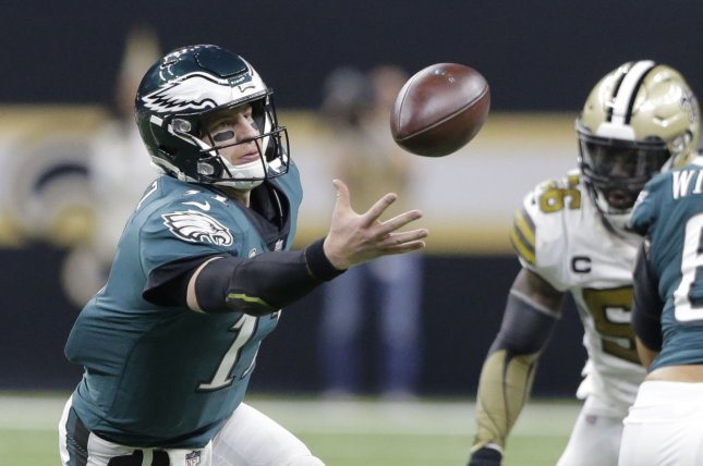 Philadelphia Eagles quarterback Carson Wentz mishandles a snap during a game against the New Orleans Saints at the Mercedes-Benz Superdome on November 18, 2018. Photo by AJ Sisco/UPI.